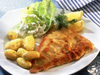 Panierter Fisch mit Kartoffeln